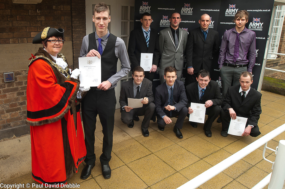 Mayor of Barnsley cllr Karen Dyson presents Oath of Allegiance certificate to Jamie Warren and (back row left to right) Rikki Cardwell, Mathew Beaumont, David Dickinson, Kane Bradbury (front Row left to right) Dale Kirk, Ashley Brown,Thomas Jevons, Daniel Crossland,<br /> http://www.pauldaviddrabble.co.uk<br /> 24 February 2012<br /> Image &copy; Paul David Drabble