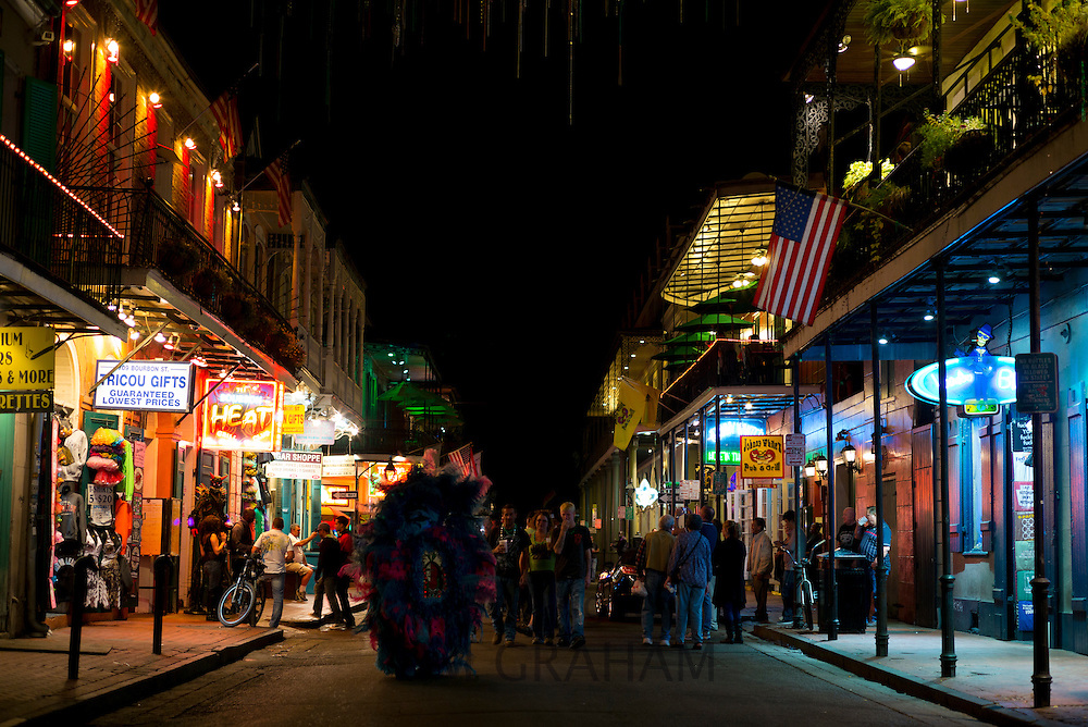 Crowds of tourists in crowded famous Bourbon Street in French Quarter of New Orleans, USA
