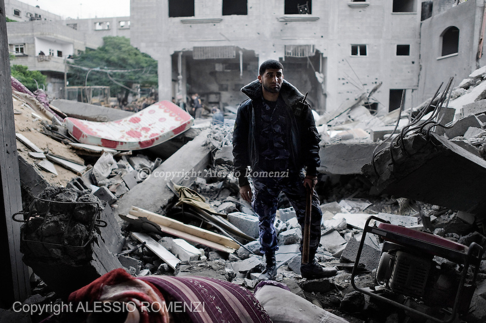 Gaza City: An Hamas Policeman stands on the rubbles of a house, after was bombed by Israeli Air Force. November 17, 2012. ALESSIO ROMENZI