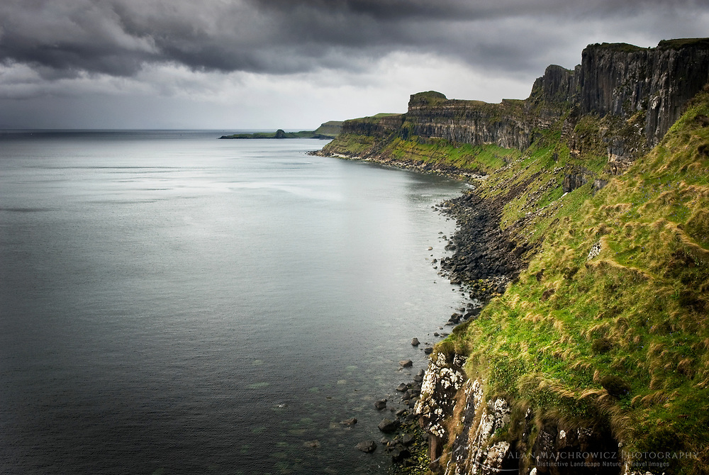 Dunite cliffs on the coast of Isle of Skye Scotland, Kilt Rock is in the distance.
