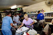 "Lori Pearson volunteers at a food bank outside of Sun City, Arizona August 2010. Sun City is called ""the city of volunteers"" and there are several opportunities for the active residents to give back..2010 marks the 50th anniversary of the United States' first planned retirement city. When Del Webb created Sun City and it opened in 1960, it was a revolutionary idea for retirees to move away from home and to live extremely active and social lifestyles.."