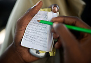 "Rap kreyol artist 2Double works on his lyrics in Port-au-Prince, Haiti on July 21, 2008. He says he hopes his music can lift his family out of the abject poverty that plagues the majority of the citizens of Haiti. ""The music is a way of surviving for him,"" says friend Sayid Louis."