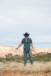 cowboy with a rope in a field