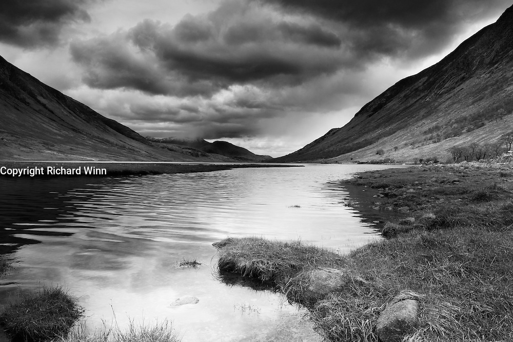 Looking west in the direction of the coast, from the head of Loch Etive, near Glen Coe. To the left is the lower slope of Ben Starav.