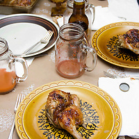 A plate of ginger, shallot, apricot glazed cornish hen awaits its sides of mashed mayhem and roasted root vegetables.