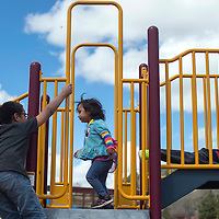 Angelique Watchman, middle, runs between the slides of the jungle gym at the Navajo Nation Zoo in Window Rock during the annual Zoo Fest Saturday.