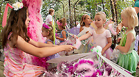 McKenzie Tarr gets her own tiara and boa as she meanders through the enchanted displays at Cackleberries in Meredith for their annual Fairy Night in the Garden Wednesday evening.  (Karen Bobotas/for the Laconia Daily Sun)