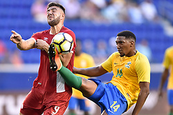 July 7, 2017 - Harrison, New Jersey, U.S - French Guiana midfielder GREGORY LESCOT (14) clears the ball away from Canada midfielder LUCAS CAVALLINI (9) during CONCACAF Gold Cup 2017 at Red Bull Arena in Harrison New Jersey Canada defeats French Guiana 4 to 2. (Credit Image: © Brooks Von Arx via ZUMA Wire)
