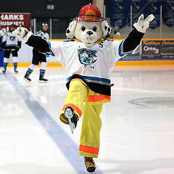 LINDSAY, ON - Feb 7 : Ontario Junior Hockey League Game Action between the Lindsay Muskies and the Aurora Tigers , Sparky the Fire Dog during the pre-game ceremony.<br /> (Photo by Andy Corneau / OJHL Images)