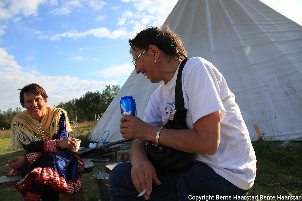 """Boazo Sami Siida, a sami camp to visit, just outside the city of Alta. Man dressed in the traditional sami """"kofte"""", from the Kautokeino-district of Northern Norway."""