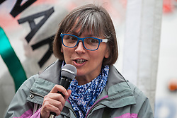 London, UK. 3 May, 2019. Theresa Alessandro, Director of Pax Christi, addresses campaigners from the Campaign for Nuclear Disarmament (CND), Stop the War Coalition, the Peace Pledge Union, the Quakers and other faith groups protesting outside Westminster Abbey against the holding of a National Service of Thanksgiving to mark fifty years of the Continuous at Sea Deterrent (CASD) attended by dignitaries including the Duke of Cambridge and the newly appointed Defence Secretary Penny Mordaunt.
