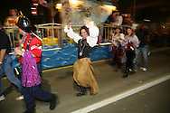Tracy McGovern of the Krewe of Charlotte de Berry dances on during the Sant Yago Knight Parade in Tampa / Ybor City, Florida.  The event attracted more than 100,000 people.