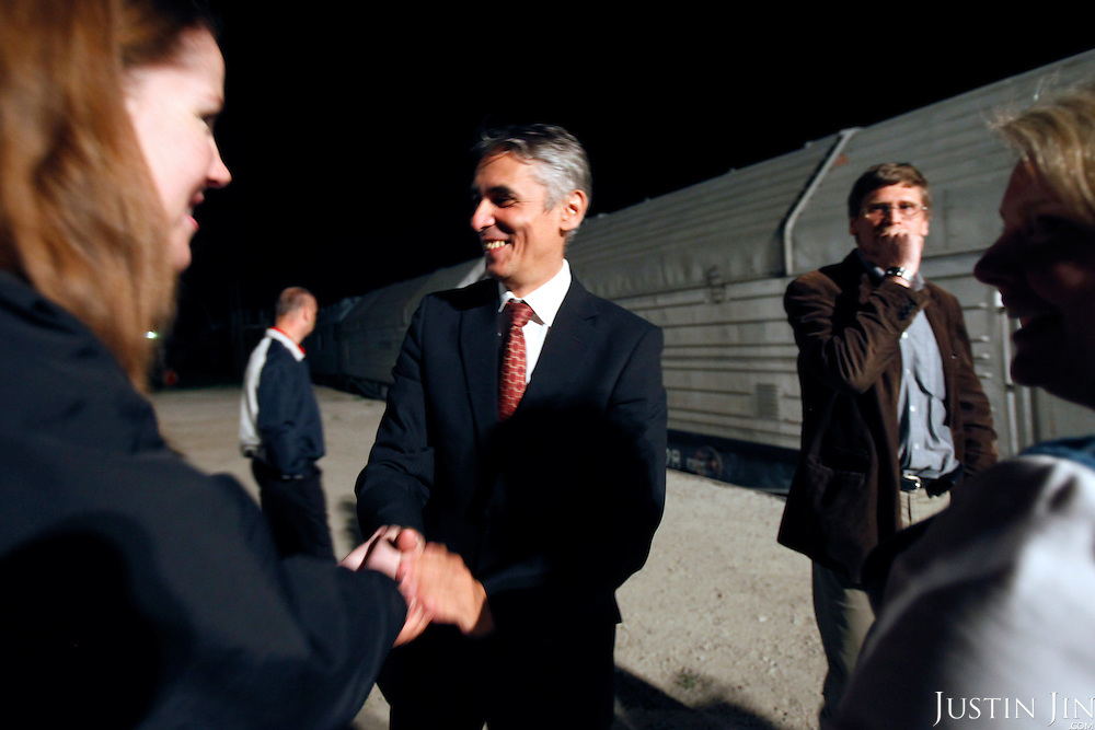 Adil Tuleushev, director of Kazakhstan's Institute of Nuclear Physics, shakes hands with American official Kelly Cummins as an armoured train carrying highly enriched uranium pulls away from Almaty, Kazakhstan, where the radioactive substance will be brought to Russia for downgrading. .The removal of Kazakhstan's highly enriched uranium (HEU) is part of the U.S. Global Threat Reduction Initiative (GTRI), where Igor Bolshinsky and Kelly Cummins work, that tries to secure nuclear material around the world to prevent their misuse by terrorists and rogue states.