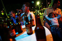 A man has a drink of beer at an outdoor table at a bar on the main plaza in Leiva, a small remote village in the southern Colombian state of Nariño, on June 24, 2007. Leiva has long been a coca village; most of the people who live in the area have long relied on the coca business in order to make ends meet. But with increasing pressure by the Colombian government, with fumigation and manual eradication of the coca fields, many people are now trying to figure out what the will do if they can?t rely on their meager coca profits. (Photo/Scott Dalton)