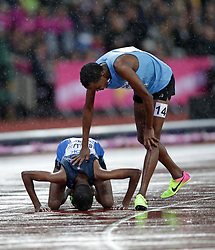 Athlete Refugee Team's Kadar Omar Abdullahi (left) and Somalia's Mohamed Daud Mohamed after the Men's 5,000m heats during day six of the 2017 IAAF World Championships at the London Stadium.