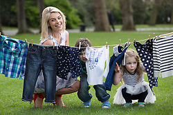 Repro Free: 09/04/2014 Model mum, Pippa O'Connor, pictured with Daniel Braide and Ella May Melia (both age 4) as they launch the new kids range at Heatons. The new collection is currently available from all Heatons stores and online www.heatonsstores.com Picture Andres Poveda