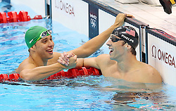 USA's Michael Phelps (right) is congratulated by South Africa's Chad Le Clos after winning the Men's 100m Butterfly Final at the Aquatics Centre in the Olympic Park, London, on the seventh day of the London 2012 Olympics.