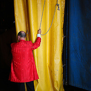 The Ringmaster prepares to open the curtains into the tent backstage at the Cole Brother Circus in Wilmington, North Carolina.