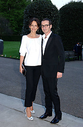 BRUNO FRISONI and model SAFFRON ALDRIDGE at a party to celebrate the opening of Roger Vivier in London held at The Orangery, Kensington Palace, London on 10th May 2006.<br />