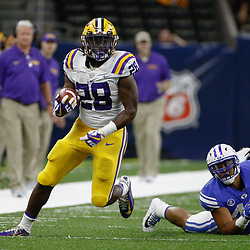 Sep 2, 2017; New Orleans, LA, USA; LSU Tigers running back Darrel Williams (28) escapes a tackle by Brigham Young Cougars linebacker Johnny Tapusoa (42) during the second quarter of the AdvoCare Texas Kickoff game at the Mercedes-Benz Superdome. Mandatory Credit: Derick E. Hingle-USA TODAY Sports