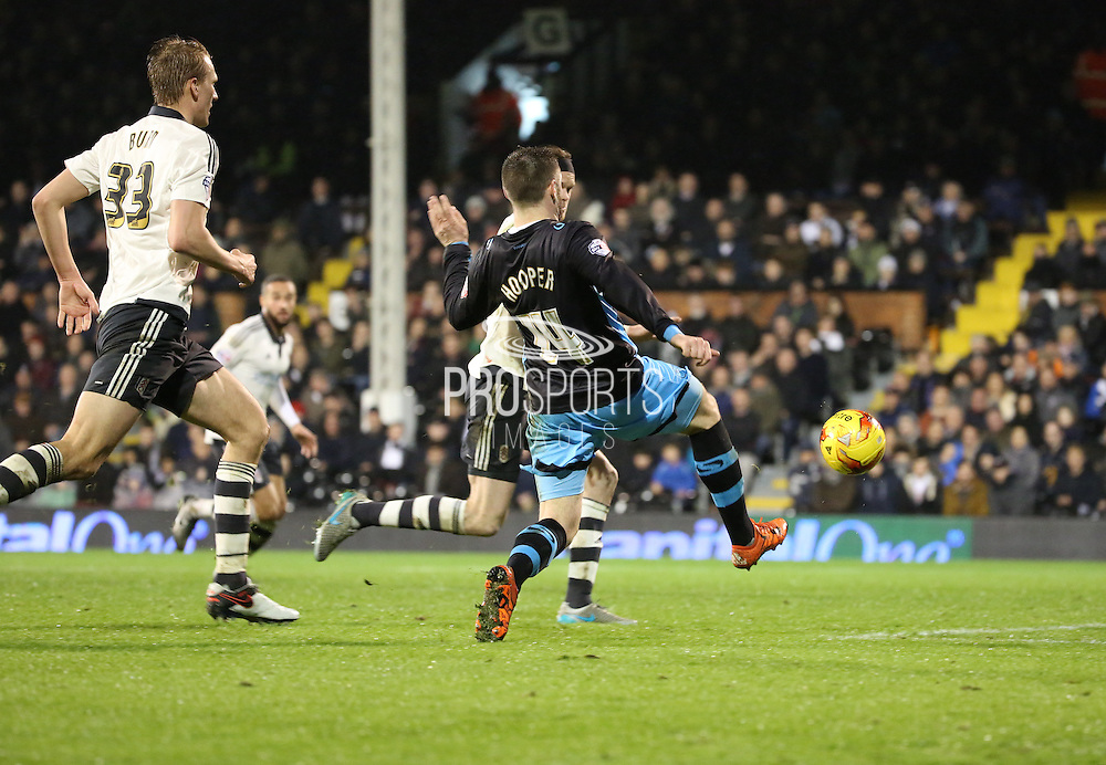 Fulham defender Richard Stearman just beating Sheffield Wednesday striker Gary Hooper to the bal otherwise he was clean through during the Sky Bet Championship match between Fulham and Sheffield Wednesday at Craven Cottage, London, England on 2 January 2016. Photo by Matthew Redman.