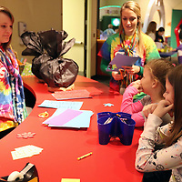 Libby Ezell | BUY AT PHOTOS.DJOURNAL.COM<br /> Emilly Morris, 9, and her sister Haily, 7 right, visit the Snowman Hat Decorating station Saturday at Healthworks 7th Birthday ran by Sara Beth Cruse, left