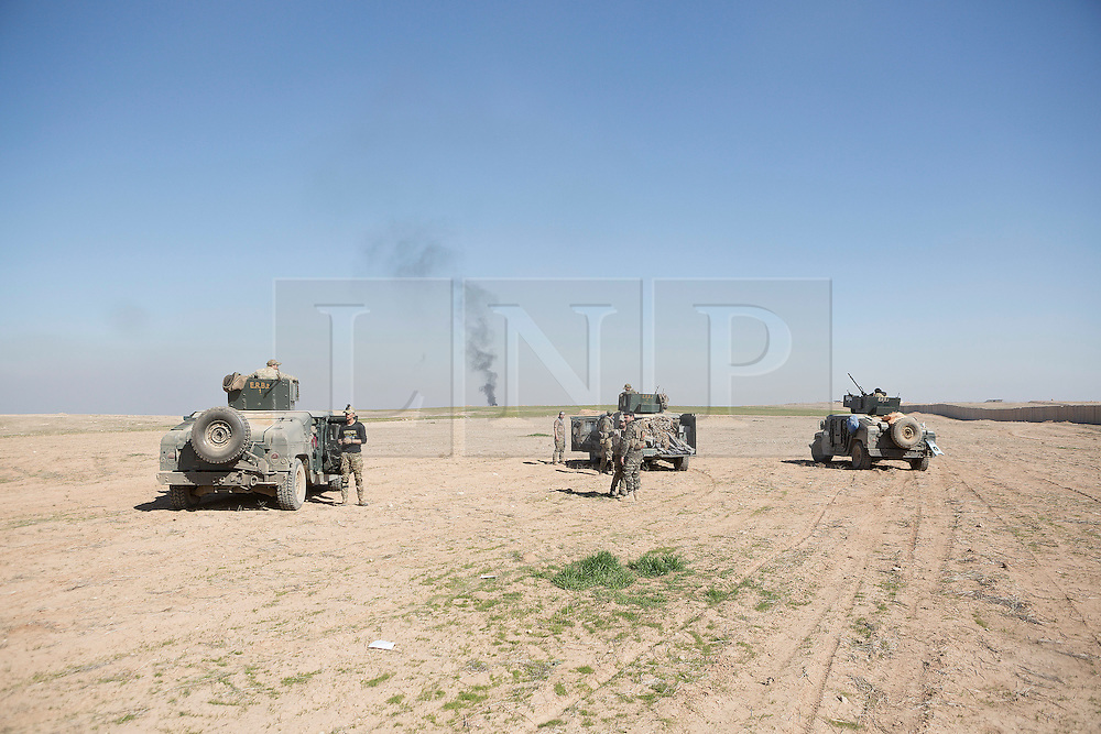 Licensed to London News Pictures. 20/02/2017. Albu Saif, Iraq. Iraqi Emergency Response Division soldiers form up as they prepare to advance on the village of Albu Saif as they take part in the offensive to retake western Mosul from the Islamic State.<br /> <br /> The settlement of Albu Saif is located on high ground overlooking Mosul Airport and as such is a strategic point that needs to be taken as part of the operation to retake the western side of Mosul. Photo credit: Matt Cetti-Roberts/LNP
