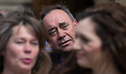 UNITED KINGDOM, London: 11 May 2015. Alex Salmond is photographed with First Minister of Scotland, Nicola Sturgeon (not pictured) out side the House's of Parliament with all 56 newly elected Scottish National Party MP's out side the House's of Parliament for a photo-call. London, England. Andrew Cowie / Story Picture Agency