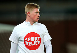 Kevin De Bruyne of Manchester City wears a Sport Relief top during the warm up at Stoke City - Mandatory by-line: Robbie Stephenson/JMP - 12/03/2018 - FOOTBALL - Bet365 Stadium - Stoke-on-Trent, England - Stoke City v Manchester City - Premier League