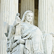 Contemplation of Justice statue by James Earle Fraser on the north side of the entrance to the US Supreme Court Building in Washington DC
