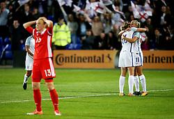 Toni Duggan of England celebrates after scoring her sides sixth goal as Anna Belomyttseva of Russia looks dejected - Mandatory by-line: Matt McNulty/JMP - 19/09/2017 - FOOTBALL - Prenton Park - Birkenhead, United Kingdom - England v Russia - FIFA Women's World Cup Qualifier