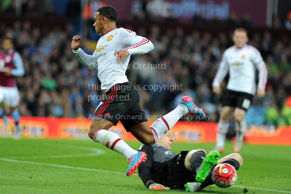 Brad Guzan of Aston Villa slides in to deny Memphis Depay of Manchester utd. Barclays Premier League match, Aston Villa v Manchester Utd at Villa Park in Birmingham, Midlands on Friday 14th August  2015.<br /> pic by Andrew Orchard, Andrew Orchard sports photography.