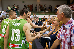 Domen Lorbek of Slovenia and Mojca Dragic, mother of Goran and Zoran Dragic after the friendly match between National teams of Slovenia and Republic of Macedonia for Eurobasket 2013 on July 28, 2013 in Litija, Slovenia. Slovenia defeated Macedonia 63-54. (Photo by Vid Ponikvar / Sportida.com)