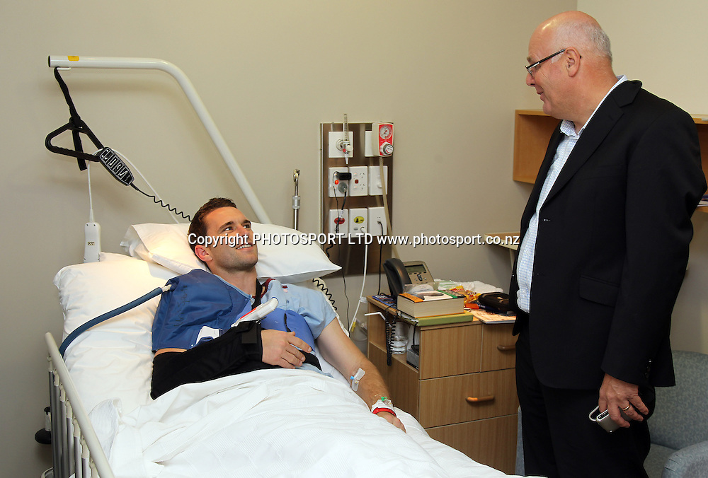 New Zealand All Whites vice captain Tim Brown who injured his shoulder against Australia in his hospital bed as he talks to NZ Football CEO Michael Glading at Southern Cross Hospital, Newmarket, Auckland, Friday 28 May 2010. Photo: Andrew Cornaga/PHOTOSPORT