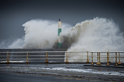 "© London News Pictures. 08/02/2014. Aberystwyth, UK. <br /> A giant waves strike the lighthouse at Aberystwyth, Wales at high tide. The winds are forecast to strengthen throughout the day, gusting up to 70 or 80 mph, and with the rising tide, their impact could be potentially damaging again. An amber ""be prepared"" warning  has been issued by the Met Office for wind,. Photo credit: Keith Morris/LNP"