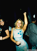 Woman dancing in a blue dress Ibiza 1999