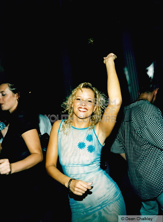 Woman dancing in a blue dress Ibiza 1999