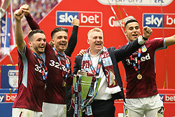 May 27, 2019 - London, England, United Kingdom - JohnMcGinn (7) of Aston Villa, Jack Grealish (10) of Aston Villa, Aston Villa Manager Dean Smith and Anwar El Ghazi (22) of Aston Villa celebrate after winning the EFL Championship Play-Off Final  during the Sky Bet Championship Play Off Final between Aston Villa and Derby County at Wembley Stadium, London on Monday 27th May 2019. (Credit Image: © Mi News/NurPhoto via ZUMA Press)