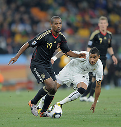 CACAU goes past Kevin Prince BOATENG (Ghana) during the 2010 FIFA World Cup South Africa Group D match between Ghana and Germany at Soccer City Stadium on June 23, 2010 in Johannesburg, South Africa.