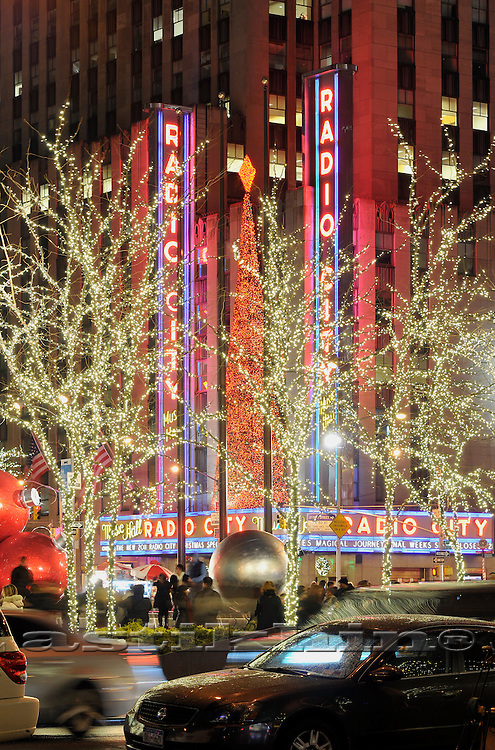 New York City, NY, New York, downtown, Radio City Music Hall, Christmas Spectacular, neon lights, evening.