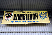 AFC Wimbledon sign during the EFL Sky Bet League 1 match between AFC Wimbledon and Gillingham at the Cherry Red Records Stadium, Kingston, England on 12 September 2017. Photo by Matthew Redman.