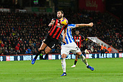 Steve Cook (3) of AFC Bournemouth battles to win the ball off Laurent Depoitre (20) of Huddersfield Town during the Premier League match between Bournemouth and Huddersfield Town at the Vitality Stadium, Bournemouth, England on 4 December 2018.