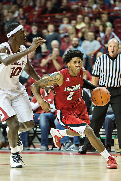 FAYETTEVILLE, AR - NOVEMBER 15:  Elfrid Payton #2 of the Louisiana Ragin' Cajuns dribbles the ball down the court during a  game against the Arkansas Razorbacks at Bud Walton Arena on November 15, 2013 in Fayetteville, Arkansas.  The Razorbacks defeated the Ragin' Cajuns 76-63.  (Photo by Wesley Hitt/Getty Images) *** Local Caption *** Elfrid Payton