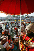 Sadhus (Hindu ascetics) congregate to bathe in the Shipra River during the Kumbh Mela festival, Ujjain, Madhya Pradesh, India. (From the book What I Eat: Around the World in 80 Diets.) The Kumbh Mela festival is a sacred Hindu pilgrimage held 4 times every 12 years, cycling between the cities of Allahabad, Nasik, Ujjain and Haridwar.  Participants of the Mela gather to cleanse themselves spiritually by bathing in the waters of India's sacred rivers.  Kumbh Mela is one of the largest religious festivals on earth, attracting millions from all over India and the world.  Past Melas have attracted up to 70 million visitors.
