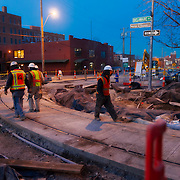 Kansas CIty streetcar line construction work underway at Third & Delaware Streets, River Market area of downtown Kansas City, Missouri at dusk.