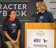 Ariel DeLeon, left, reacts after Lynn Cooke, right, announced she had won two tickets to Super Bowl LI during the Houston launch of the Character Playbook, a joint initiative of the NFL and the United Way Worldwide at Pilgrim Academy, February 3, 2017.