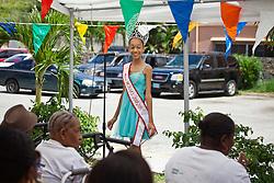 Miss BCB Shania Farrington talks to seniors about how she won her crown.  Mini Carnival at Lucinda Millin Home for the Aged.  St. Thomas, USVI.  11 April 2015.  © Aisha-Zakiya Boyd