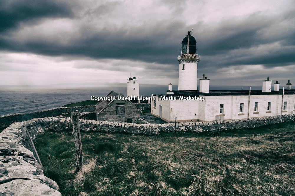 Lighthouse at Dunnet Head, most northerly point on mainland UK. Orkney visible in distance.