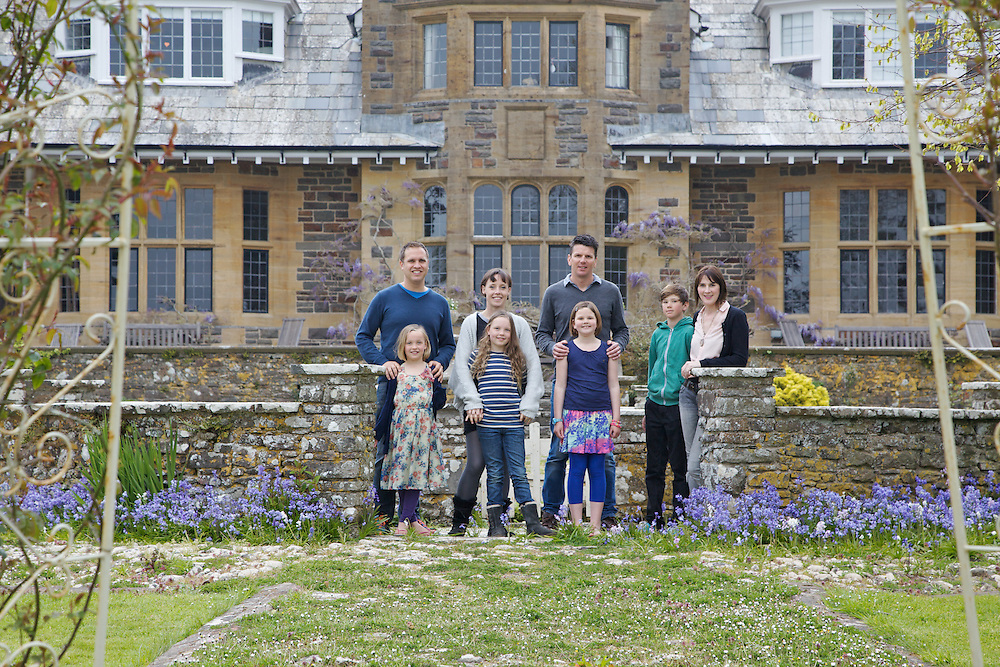 The Elliott and Baker families in the garden at Pickwell Manor. From left to right: Richard Eliott, Millie-grace Elliott (8), Tracey Elliott, Molly Elliott (10), Steve Baker, Liza Baker (9), Zac Baker (11), Susannah Baker. Pickwell Manor, Georgeham, North Devon, UK.<br /> CREDIT: Vanessa Berberian for The Wall Street Journal<br /> HOUSESHARE