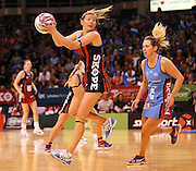 Anna Thompson Tactix captain gathers the ball with Stacey Peeters of the Steel in defence during the ANZ Championship Netball game between the Tactix v Steel at Horncastle Arena in Christchurch. 6th April 2015 Photo: Joseph Johnson/www.photosport.co.nz